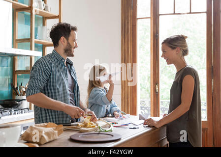 Family spending time together in kitchen - Stock Photo