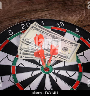 Darts on a wooden background - Stock Photo