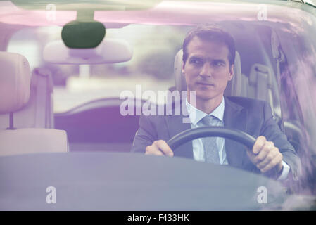 Man driving car without passengers - Stock Photo