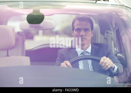 Commuter driving car without passengers - Stock Photo
