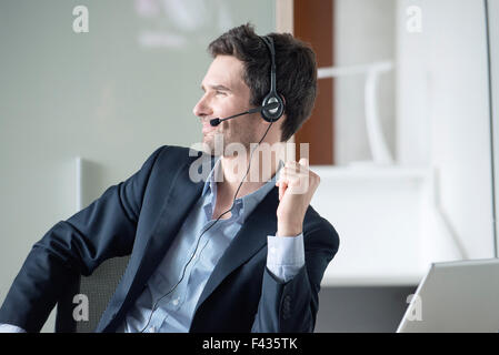 Salesman on phone call - Stock Photo