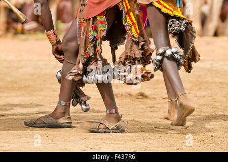 feet of Hamer women with bells at a tribal dance Omo Valley, Ethiopia - Stock Photo