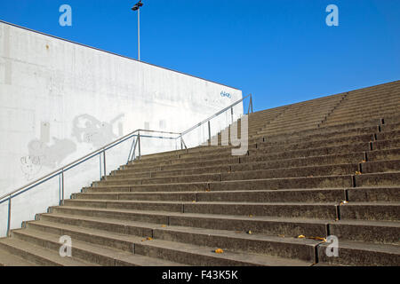 Grey barren stairs in front of a concrete wall - Stock Photo