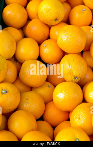 A background of fresh clementines on a market - Stock Photo