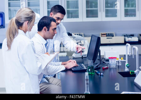 Science students working together in the lab - Stock Photo