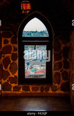 Window in view of golden horn Galata Tower in Istanbul. - Stock Photo