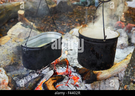 Two pots above the fire. - Stock Photo