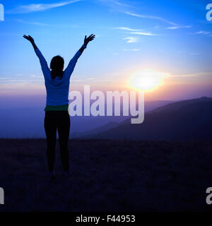 Silhouette of young woman - Stock Photo