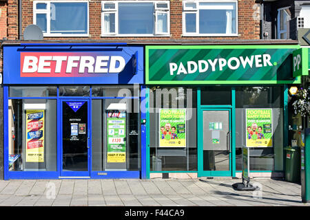 Betting shops next door to each other betting posters in windows in High Road between Seven Kings &Goodmayes near - Stock Photo