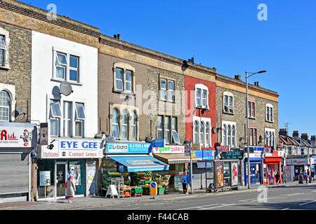 High Road shopping street including post office with residential flats above close to Seven Kings railway station - Stock Photo