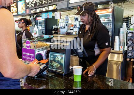 Key West Florida Keys McDonald's fast food restaurant inside counter Black woman employee uniform cashier customer - Stock Photo