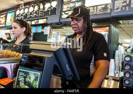 Key West Florida Keys McDonald's fast food restaurant inside counter Black woman employee uniform cashier - Stock Photo