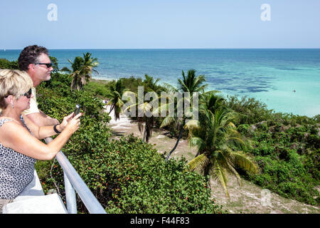 Florida Keys Route 1 Overseas Highway Bahia Honda State Park Key Old Bridge view Atlantic Ocean man woman couple - Stock Photo