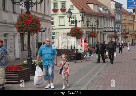 Grandpa walks with granddaughter in the town center in Zielona Gora, Poland - Stock Photo