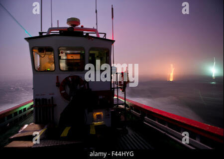 West coast rock lobster (Jasus lalandii) fishing boat (James Archer) leaves the Saldhana Bay harbour before the - Stock Photo