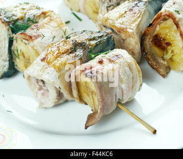 kebabs mackerel, banana and bacon - Stock Photo