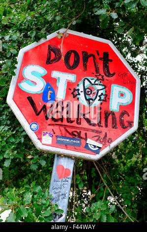 Encouraging road sign (Don't Stop Walking) on the Way of Saint James (Camino de Santiago) - Stock Photo