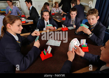 Hereford Cathedral School pupils playing the card game bridge in the classroom as part of a mathematics lesson.a UK education