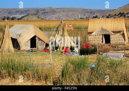 floating Uros islands on Lake Titicaca Peru which is 3800 meters above sea level, highest navigable lake in the - Stock Photo