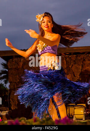 Beautiful young native woman performing traditional dance at Luau, Big Island, Hawai'i, USA - Stock Photo