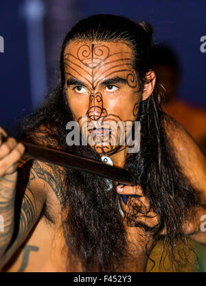 Native male Hawaiian performing traditional dance at Lua, Big Island, Hawai'i, USA - Stock Photo