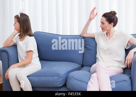 Mother scolding her naughty daughter - Stock Photo