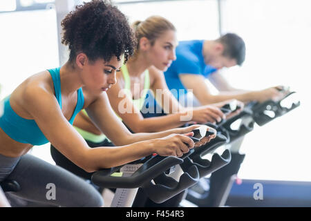 Fit people in a spin class - Stock Photo