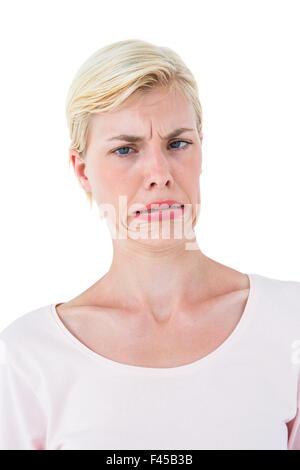 Blonde woman grimacing - Stock Photo