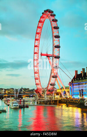 The London Eye Ferris wheel in the evening - Stock Photo