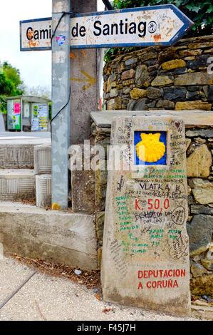 Milestone that marks the last 50 km to Santiago de Compostela in Barrio de Santa Maria de Melide,Galicia, Spain - Stock Photo