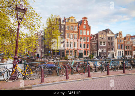 Bicycles parked on a bridge in Amsterdam - Stock Photo