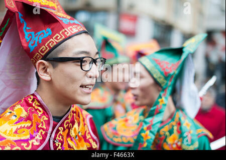 Paris, France - February 09, 2014: Chinese performers in traditional costume at the chinese lunar new year parade. - Stock Photo