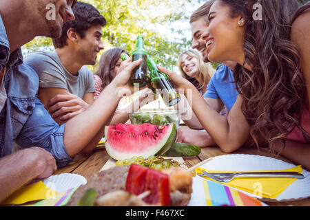 Happy friends in the park having picnic - Stock Photo