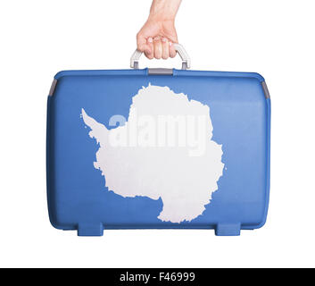 Used plastic suitcase with stains and scratches, printed with flag - Antarctica - Stock Photo