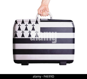 Used plastic suitcase with stains and scratches, printed with flag - Brittany - Stock Photo