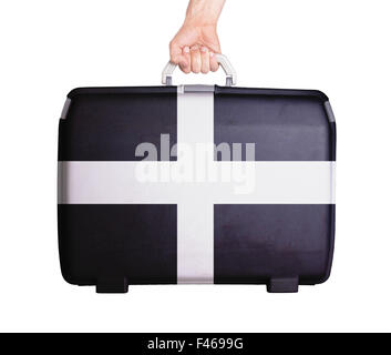 Used plastic suitcase with stains and scratches, printed with flag - Cornwall - Stock Photo