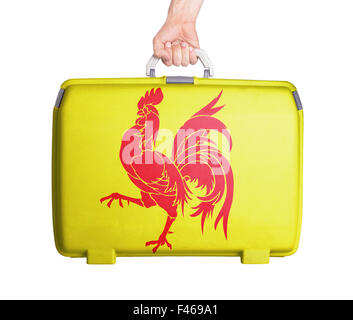 Used plastic suitcase with stains and scratches, printed with flag - Wallonia - Stock Photo
