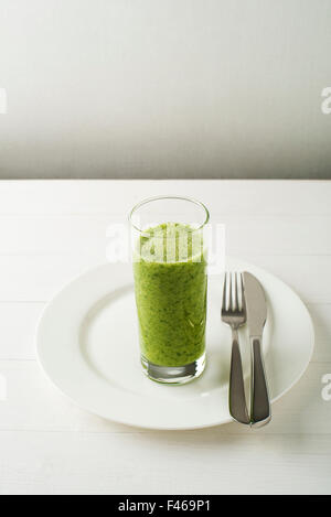 Glass of Healthy green smoothie with vegetables. - Stock Photo
