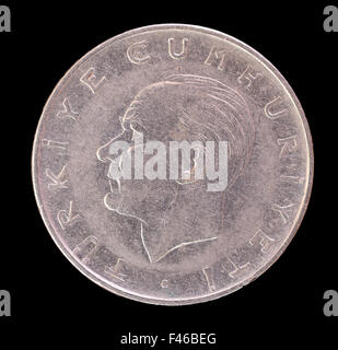 An old Turkish lira coin depicting the portrait of the first President of Turkey, Mustafa Kemal Ataturk. Image isolated - Stock Photo