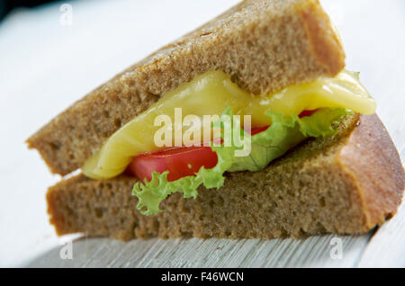 Cheese and tomato traditional sandwich. close up - Stock Photo
