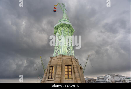 Ultra wide view of lighthouse in Kobe, stormy clouds Japan - Stock Photo