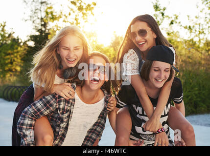 Friends hanging out on a summer day - Stock Photo