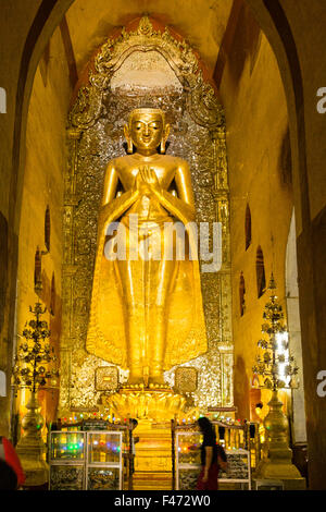 Giant golden Buddha inside Pahto Ananda, one of Bagan's 4000 temples, Bagan, Myanmar - Stock Photo