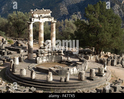 5804. The sanctuary of Athena Pronaia in Delphi. The  circular building is called 'Tholos' was built in c. 380 BC. - Stock Photo