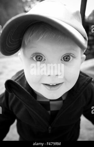 Portrait of a little boy with his eyes wide open, Sweden. - Stock Photo