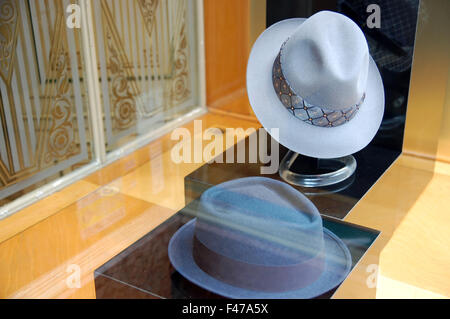 Italian hats in a shop window in Bologna, Italy - Stock Photo