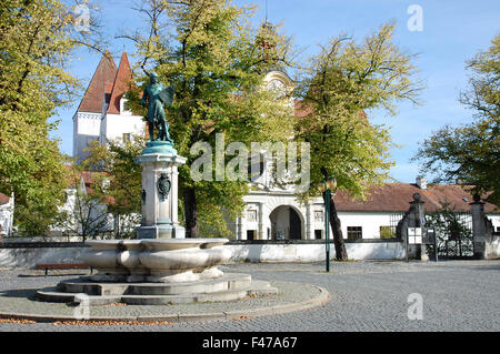 The Neues Schloss sitting behind the Ludwigsbrunnen on the Paradeplatz in Ingolstadt, Germany - Stock Photo