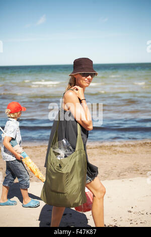 Mother and son on a sunny beach, Sweden. - Stock Photo