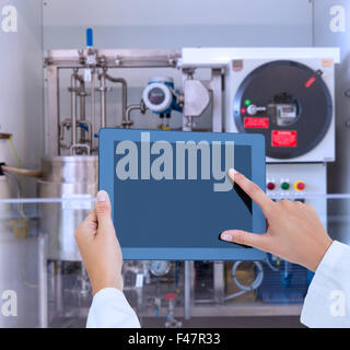 Composite image of doctor using tablet pc - Stock Photo