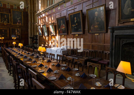 Laid dining table inside / interior of the Great Hall (the dining hall)  Christ Church, Oxford University. Oxford. - Stock Photo